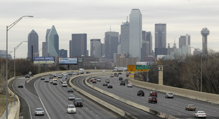 This Friday, Jan. 14, 2011 photo shows highway IH-30 traffic with the Dallas skyline in the background in Dallas.