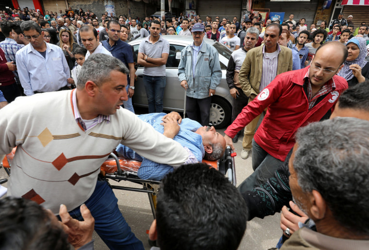 Image: A victim is seen on a stretcher in Tanta.