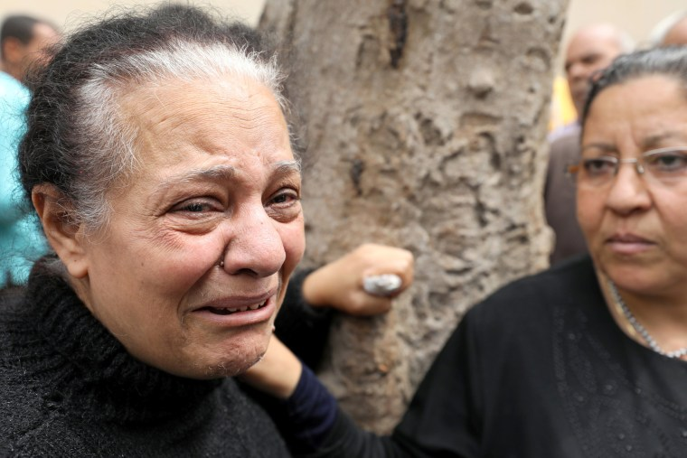 Image: A relative of one of the victims reacts after the explosion.