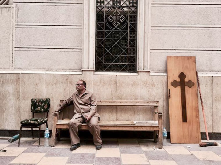 Image: A man sits on a bench outside a church after a bomb attack in the Nile Delta town of Tanta, Egypt, April 9, 2017.