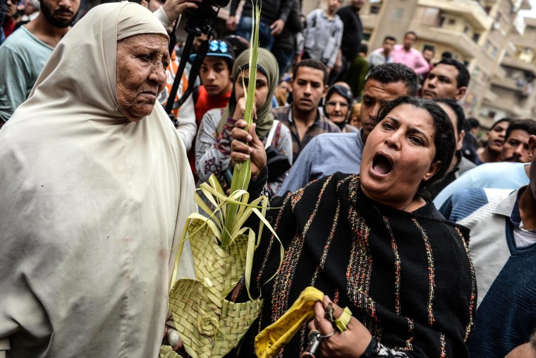Image: People gather in front of the church in Tanta.