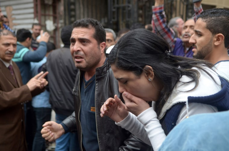 Image: People at the scene after the blast.