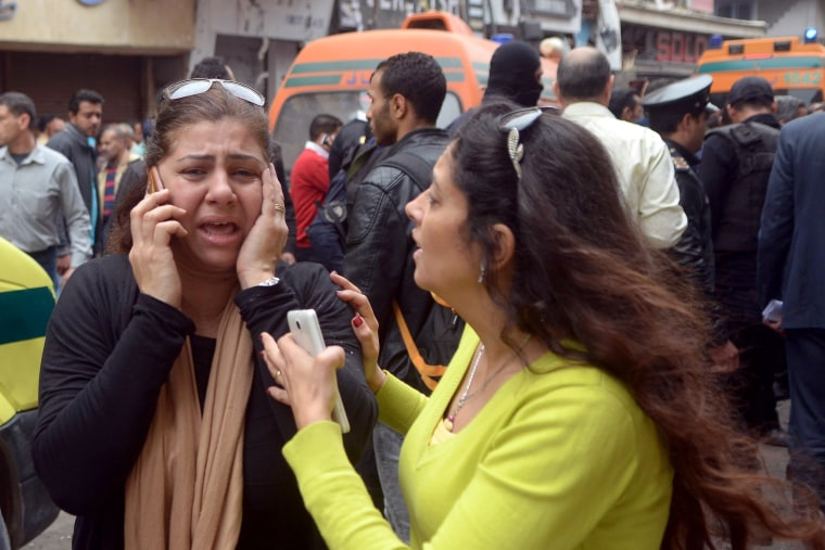 Image: Two women react outside the Saint Mark's Coptic Cathedral in Alexandria, 250km northwest of Cairo.