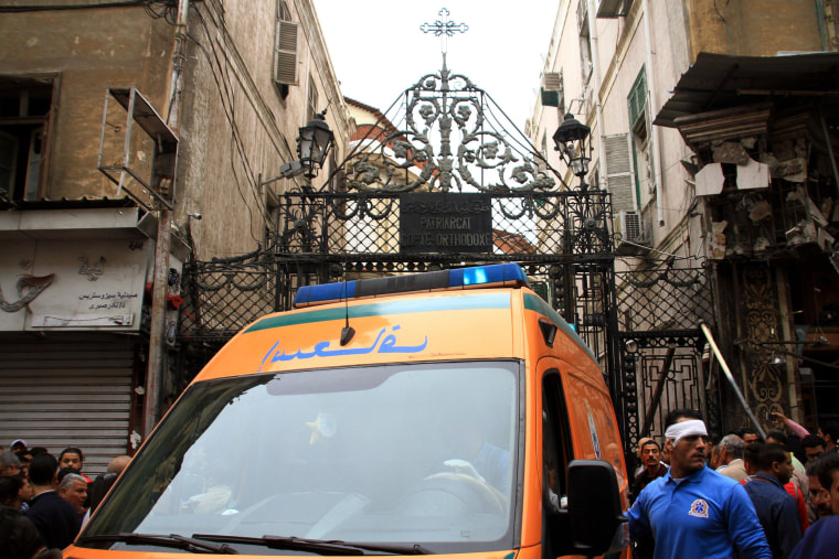 Image: An ambulance waits outside the cathedral.