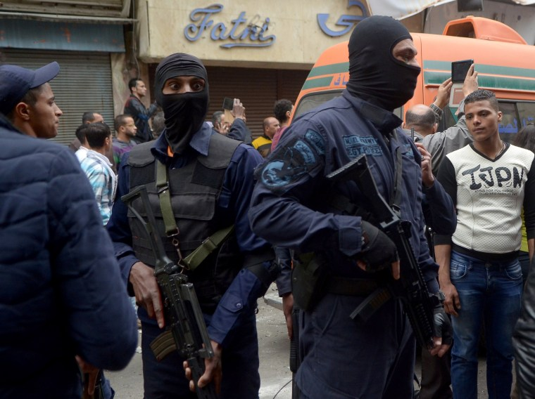 Image: Members of Egypt's special forces take their positions after the attack.