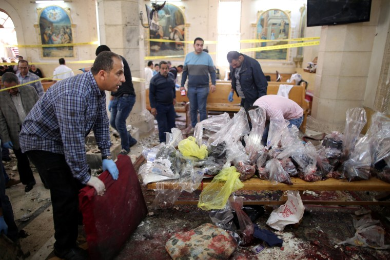 Image: Security personnel investigate the scene of the explosion in Tanta.