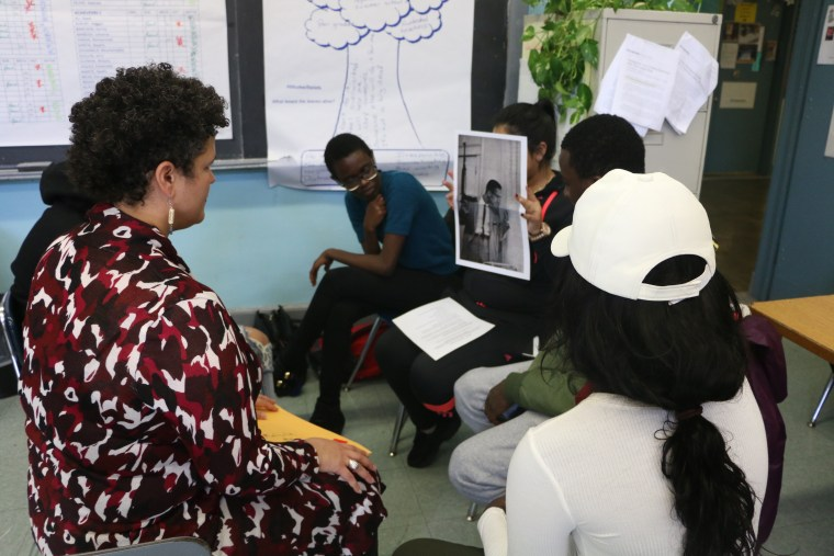 Teaching artist Signe V. Harriday leads students through an exercise at the Manhattan International High School.