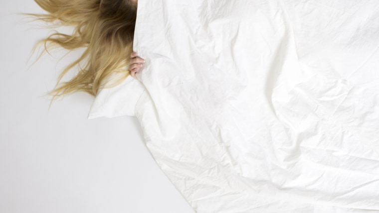 Anxiety can sometimes cause insomnia and also make you feel like you want to hide under a blanket.