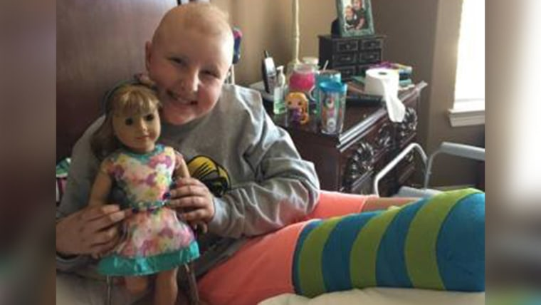 Dylan with her special American Girl doll, who has a prosthetic leg just like hers.