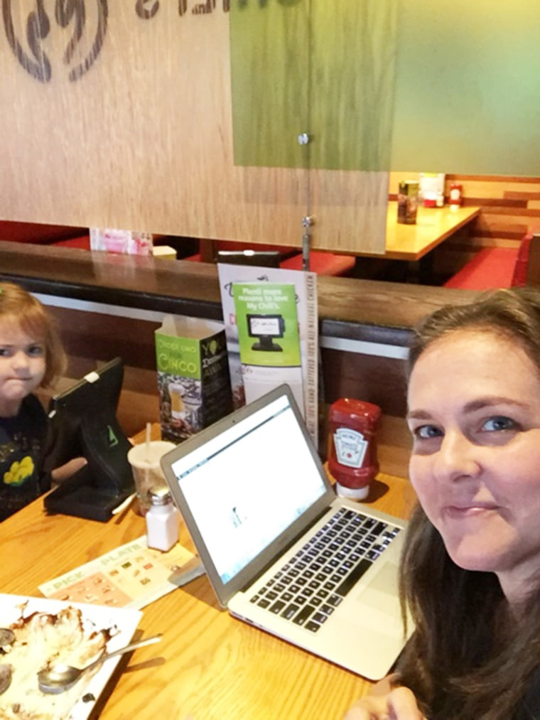On a school holiday, TODAY Parents contributing writer Allison Slater Tate finds herself working while her children eat lunch.