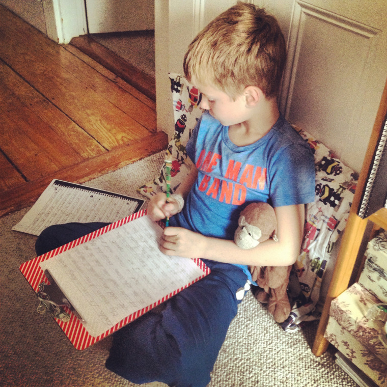 Lindsey Mead's son, Whit, sits quietly in a corner of her office while he does his own work.