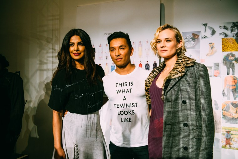 """At the finale oh his lastest New York Fashion Week show, Gurung sent his models down the runway wearing t-shirts printed with sentences including """"I am an immigrant"""" and """"Revolution has no borders."""""""