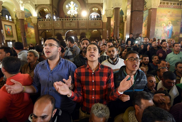 Image: Men pray for the victims of the Palm Sunday blast at the Coptic Christian Saint Mark's church in Alexandria, which took place on April 9.