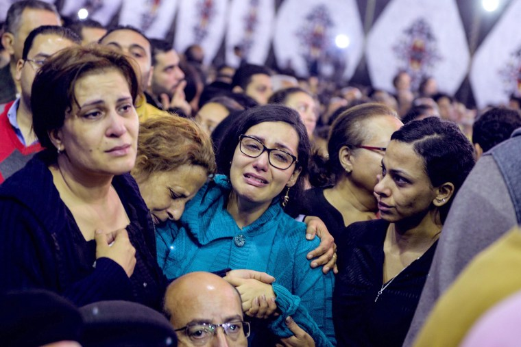 Image: Mourners gather at the Mar Girgis Coptic church in Tanta, April 10, where at least 28 were killed and 71 injured in the explosion.