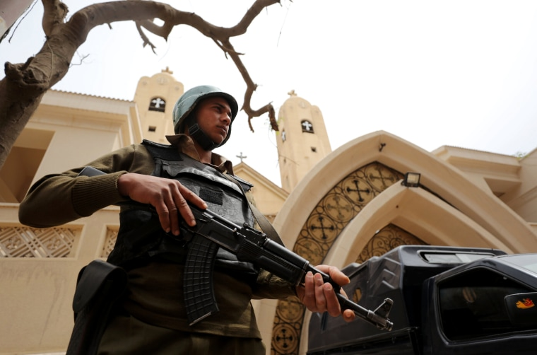 Image: An armed policeman secures the Coptic church that was bombed on Palm Sunday in Tanta, April 10.
