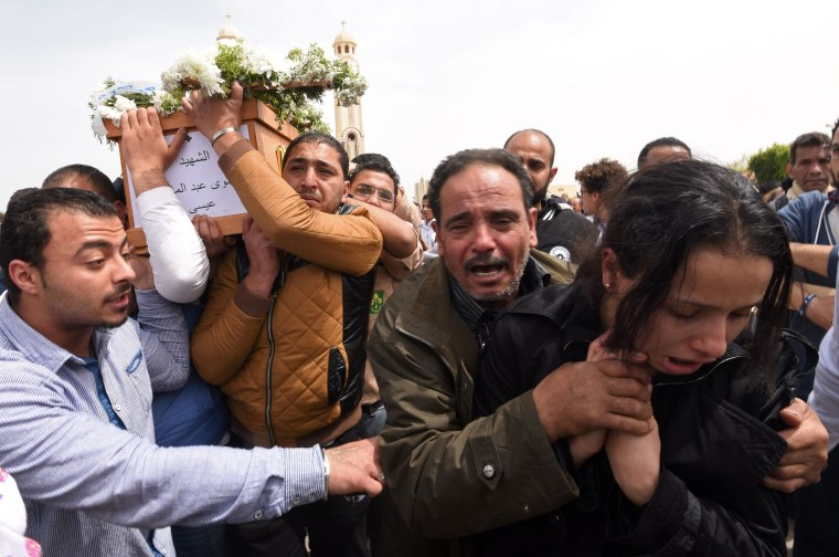 Image: Family members carry the coffin of a victim from Alexandria during a funeral procession at the Monastery of Marmina in the city of Borg El-Arab, April 10.