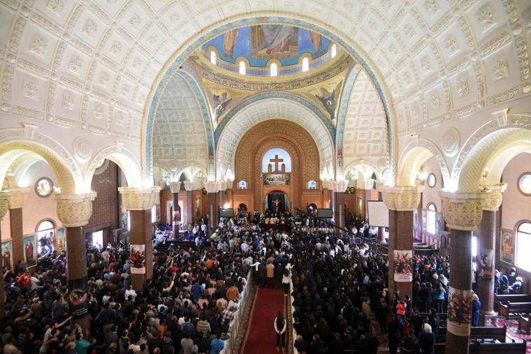 Image: People pray in the city of Borg El-Arab, April 10.