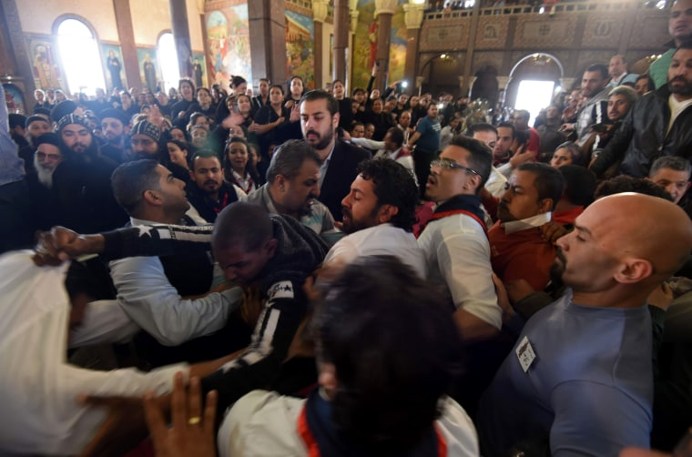 Image: Mourners react to the deaths of loved ones during a funeral procession at the Monastery of Marmina, April 10.