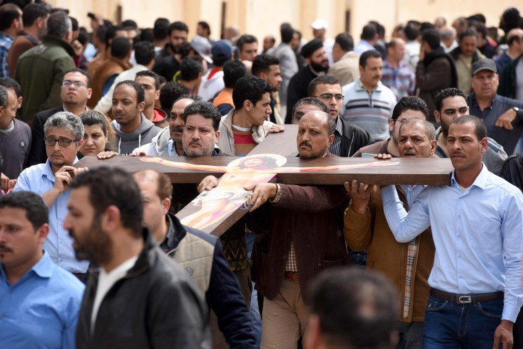 Image: Mourners carry a large cross during a funeral procession in the city of Borg El-Arab, April 10.
