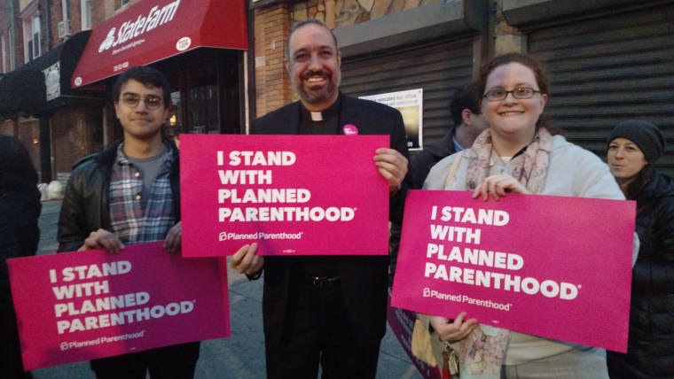 Abdullah Younus (l.) and Mary Hetteix join Rev. Khader El-Yateem. at a local demonstration to keep Planned Parenthood funded.