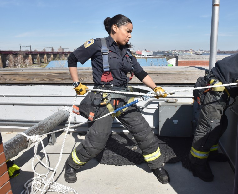 Firefighter Sarina Olmo of the FDNY's Engine 83 Ladder 29 in The Bronx, New York.