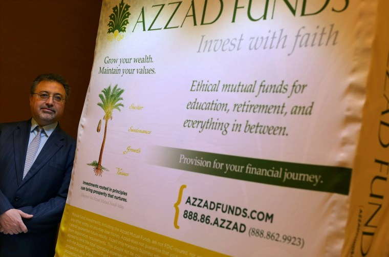 Image: Activist investor Bashar Qasem, President and CEO of Azzad Asset Management Inc, is pictured at his booth during a conference in Huntington Beach, California