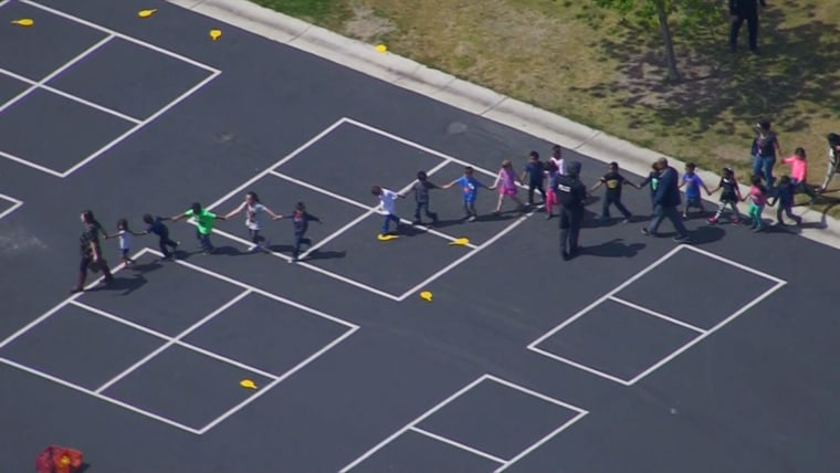 Image: Students are evacuated after a shooting at North Park Elementary School in San Bernardino