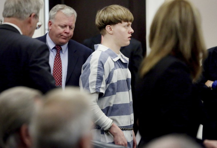 Image: Dylann Roof walks into the courtroom to enter his guilty plea on murder charges