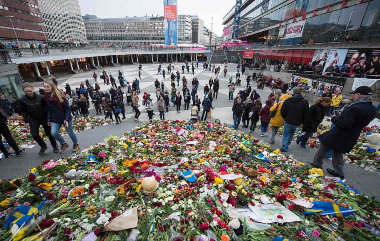 Image: A makeshift memorial commemorates the victims of Friday's terror attack in Stockholm.