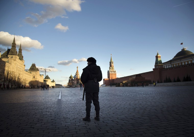 Image: A police officer stands guard in Red Square in Moscow