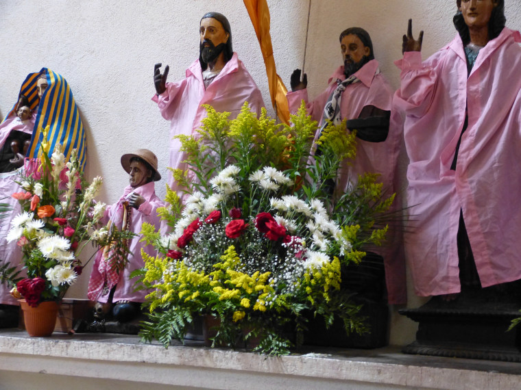 Statues of saints Inside the Church of Santiago Apostol in Santiago Atitlan are dressed in colorful clothing reminiscent of the dress of indigenous townsfolk. Flowers symbolize life and resurrection.