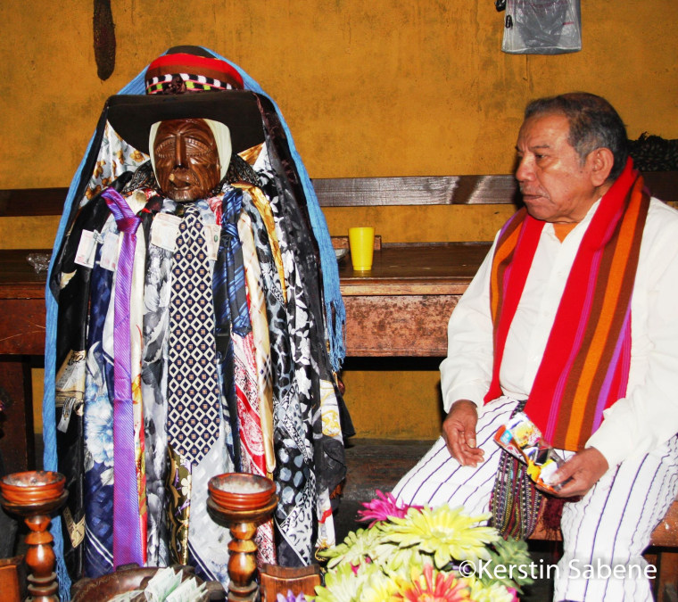 The statue of the Mayan demi-god Maximon is kept in the home of one of the members of his cofradia—the traditional brotherhood that cares for the Mayan saint—on Holy Week, he is transferred to his chapel near the Catholic Church