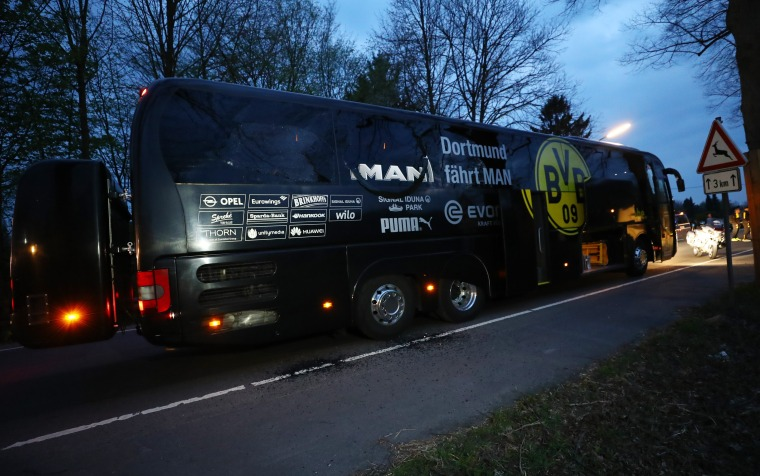Image: The Borussia Dortmund team bus is seen after an explosion near their hotel before the game