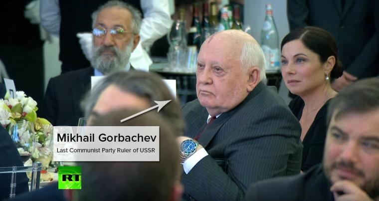 Mikhail Gorbachev sat a table behind Putin's.