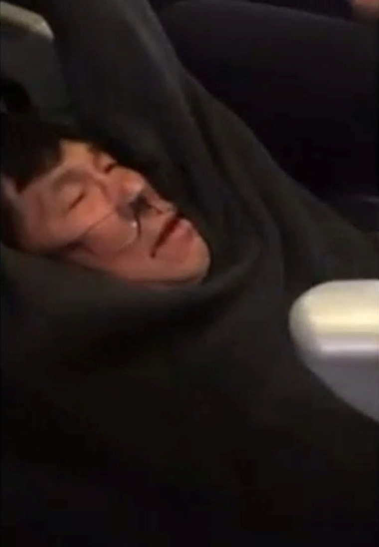 Image: A video screengrab shows passenger David Dao being dragged off a United Airlines flight at Chicago O'Hare International Airport