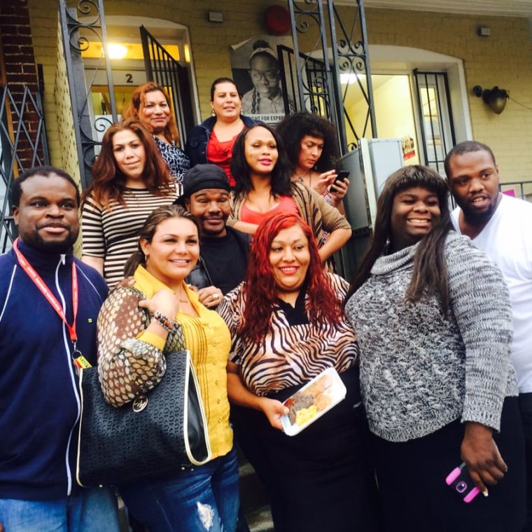 Ruby Corado (center) with members of the Casa Ruby community