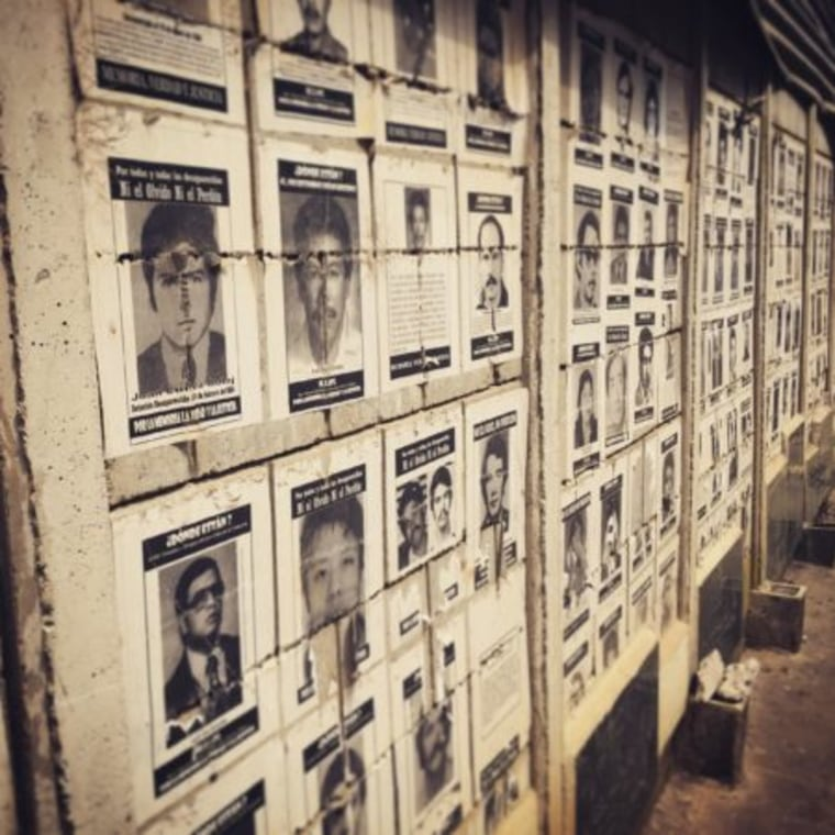 A wall of photos of the disappeared at La Verbena Cemetery in Guatemala City.