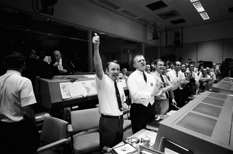 Three of the four Apollo 13 Flight Directors applaud the successful splashdown of the Command Module 'Odyssey' while Dr. Robert R. Gilruth, Director, Manned Spacecraft Center (MSC), and Dr. Christopher C. Kraft Jr., MSC Deputy Director, light up cigars (upper left). The Flight Directors are from left to right: Gerald D. Griffin, Eugene F. Kranz and Glynn S. Lunney - April 17, 1970 (Photo by NASA/ullstein bild via Getty Images)