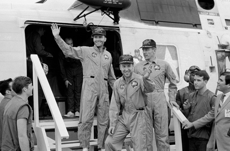 S70-35614 (17 April 1970) --- The crewmembers of the Apollo 13 mission, step aboard the USS Iwo Jima, prime recovery ship for the mission, following splashdown and recovery operations in the South Pacific Ocean. Exiting the helicopter which made the pick-up some four miles from the Iwo Jima are (from left) astronauts Fred W. Haise Jr., lunar module pilot; James A. Lovell Jr., commander; and John L. Swigert Jr., command module pilot. The crippled Apollo 13 spacecraft splashed down at 12:07:44 p.m. (CST), April 17, 1970.