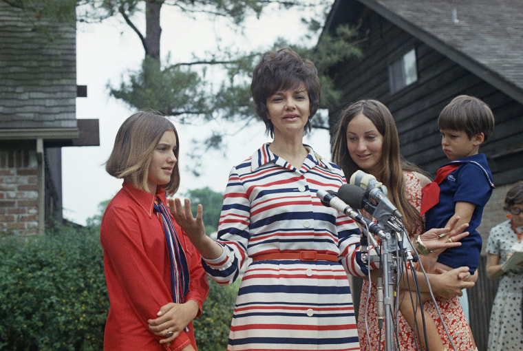 Marilyn Lovell is shown with her with children, from left, Susan, Barbara and Jeffrey, as she speaks to the media after her husband Jim Lovell's safe splashdown in Apollo 13 following its aborted lunar landing mission, April 17, 1970. (AP Photo)
