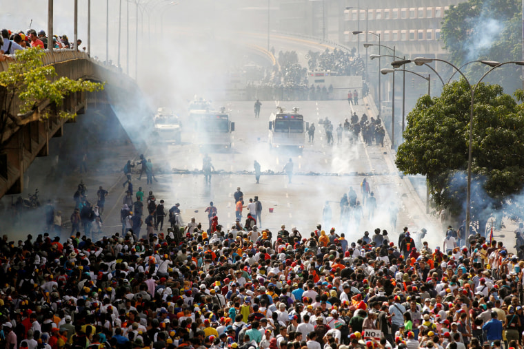 Image: Demonstrators clash with the police during protest in Venezuela