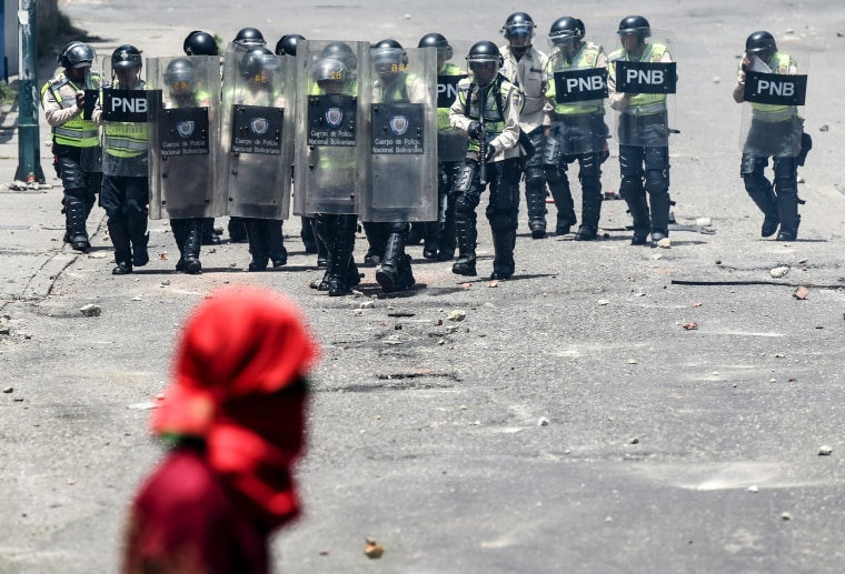 Image: Venezuelan police clash with opposition activists during a protest
