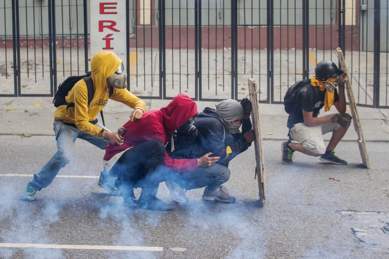 Image: Demonstrators clash with police at a protest in Venezuela