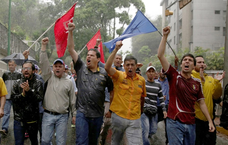 Image: Demonstrators rally against Venezuela's President in Caracas