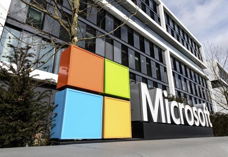 Image: The Microsoft logo on the facade of a Microsoft Center.