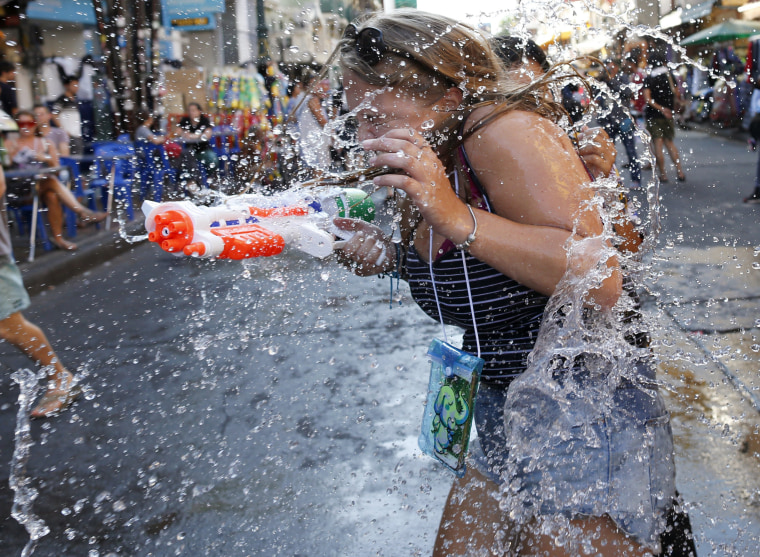 Image: Thai and foreign revelers battle with water guns