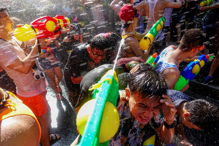 Image: Revelers take part in a water fight at Songkran Festival celebrations in Bangkok
