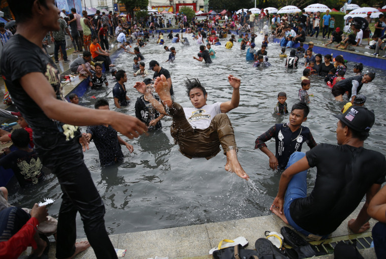 Image: Revelers swim in a pool during the Thingyan water festival in Yangon