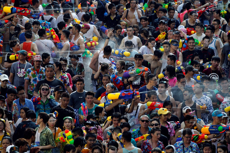 Image: Revelers participate in a water fight at Songkran Festival