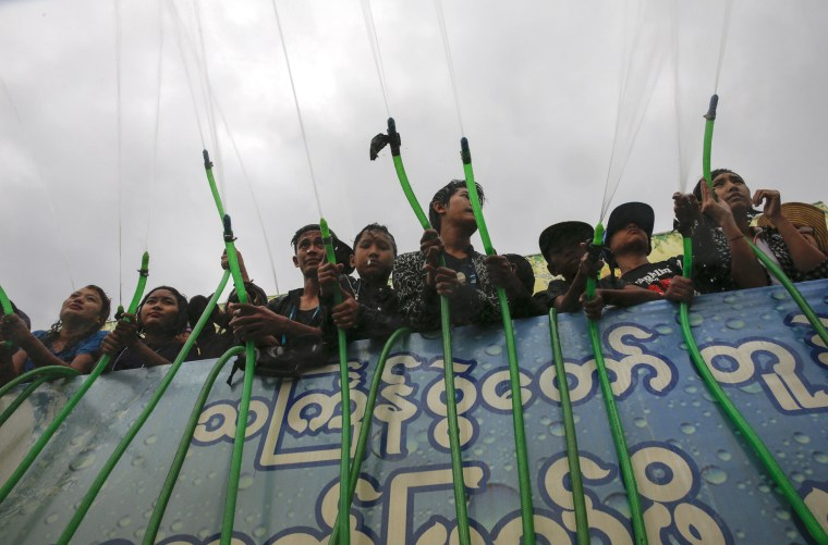 Image: Revelers hose down the crowd